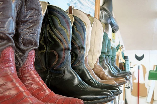 Different Cowboy Boots On Shelf