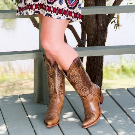 Young Woman Wearing Cowboy Boots
